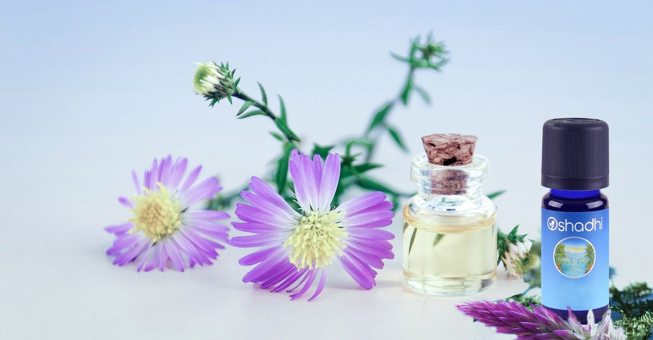 flowers and essential oil bottle