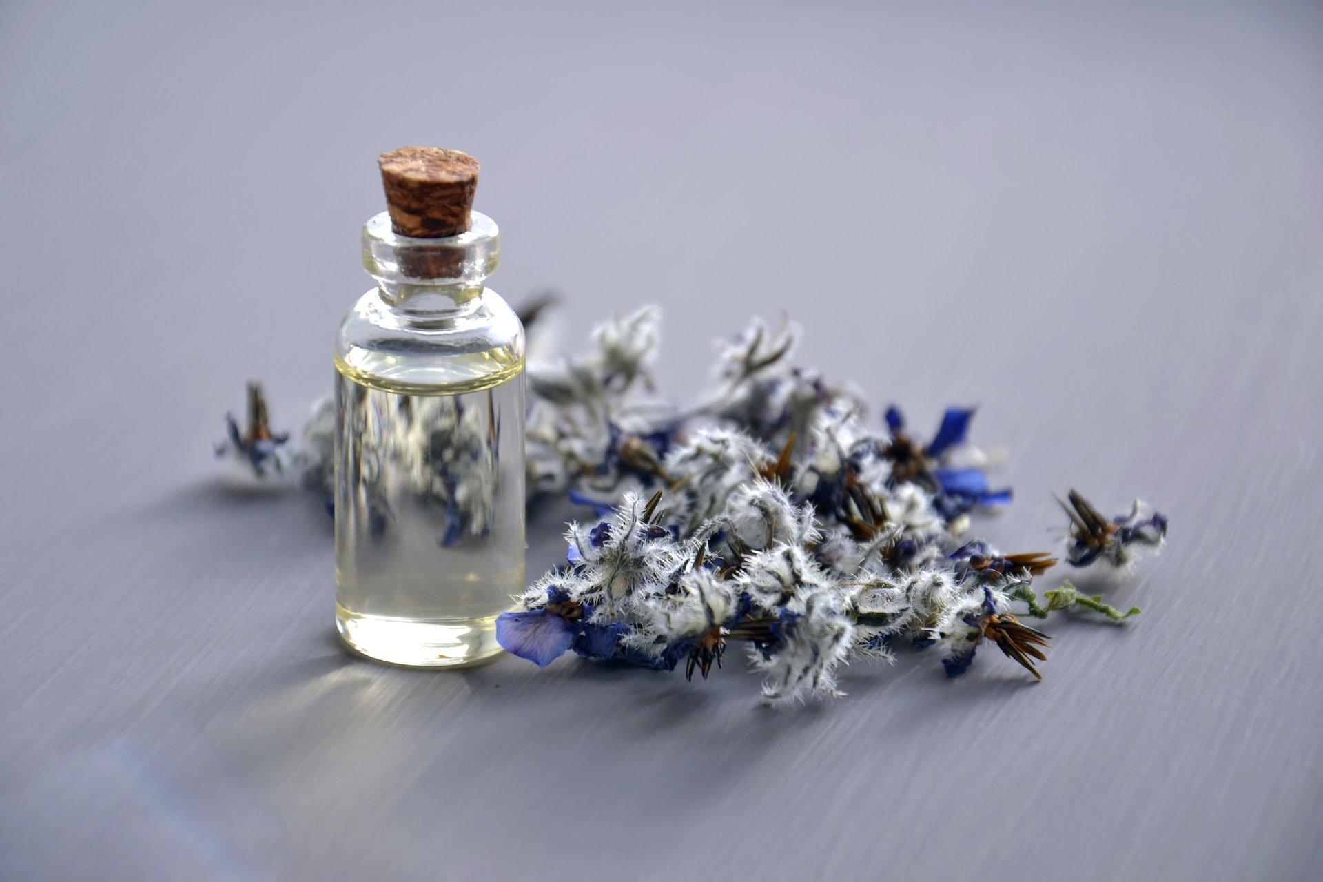 flowers and bottle of essential oil