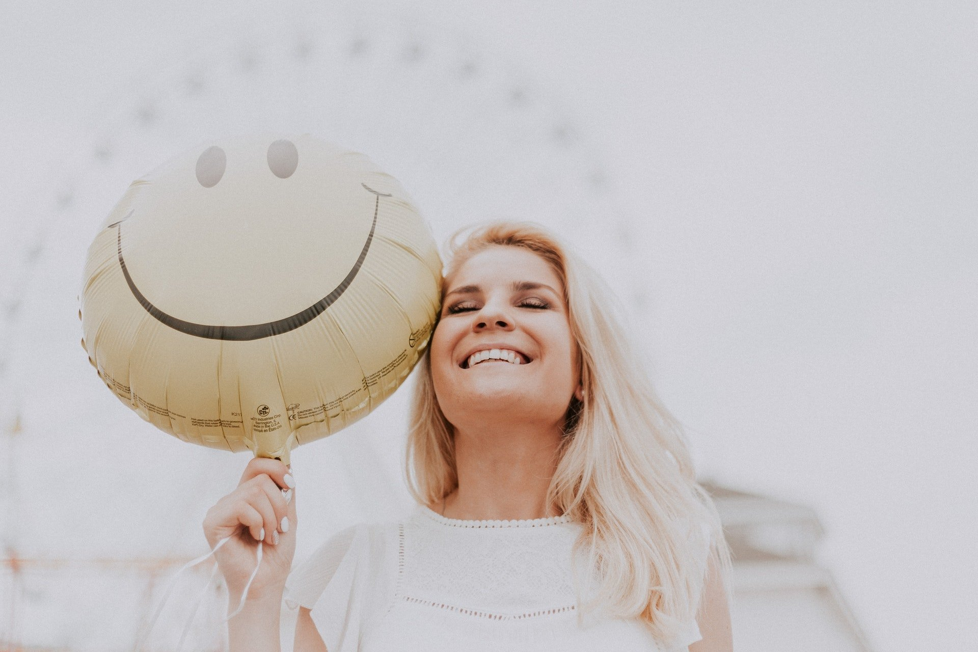 smiling person with happy face ballon
